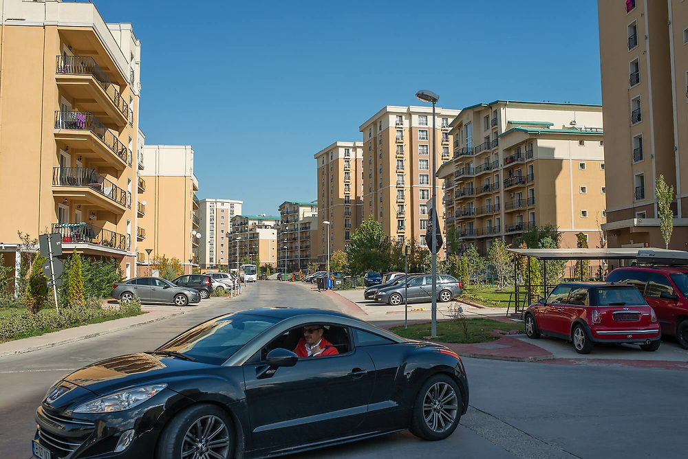 The gated community of Cosmopolis, a small community of villas, apartment blocks, shops, a kindergarten and a mall, the biggest of this type in Bucharest.