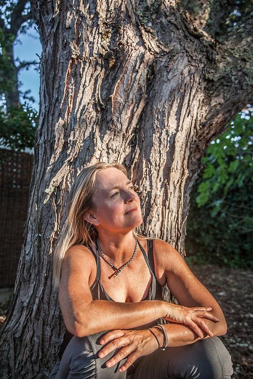Yoga instructor and neighbor Ulrika Engman in her back yard on School Street in Calistoga
