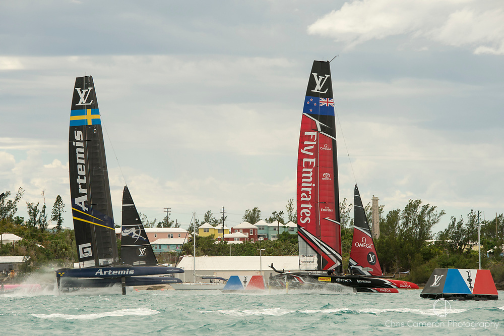 The Great Sound, Bermuda. 11th June 2017. Emirates Team New Zealand cross the finsh line one second ahead of Artemis Racing (SWE) in race six of the Louis Vuitton America's Cup Challenger playoff finals. ETNZ end the day ahead 4 - 2.