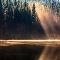 Soft sunbeams in the lake