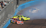 Nov. 14, 2009; Avondale, AZ, USA; NASCAR Nationwide Series driver  Eric McClure (24), Paul Menard (98), Jason Bowles (61), and Jeremy Clements (0) crash during the Able Body Labor 200 at Phoenix International Raceway. Mandatory Credit: Jennifer Stewart-US PRESSWIRE