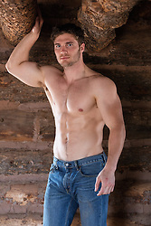 shirtless muscular man inside a cabin