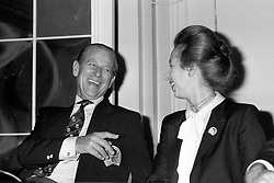 The Duke of Edinburgh shares a joke with his daughter Princess Anne at the general assembly of the International Equestrian Association at the Waldorf Hotel, London