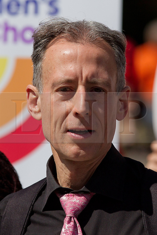 © Licensed to London News Pictures. 15/07/2013. London, UK. LGBT campaigner Peter Tatchell is seen with supporters of lesbian, gay and bisexual charity Stonewall outside Parliament in London today (15/07/2013) as MP's hear the final reading of a proposed bill to allow same sex marriages to become law. Photo credit: Matt Cetti-Roberts/LNP