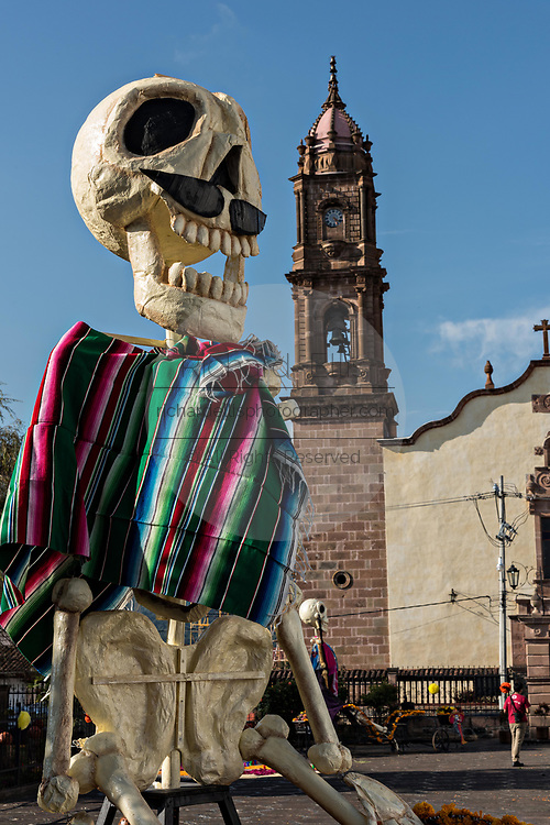 A giant skeleton decorates the plaza in front of the Immaculate Conception Santa Clara church decorated for the Day of the Dead festival in Santa Clara del Cobre, Michoacan, Mexico.