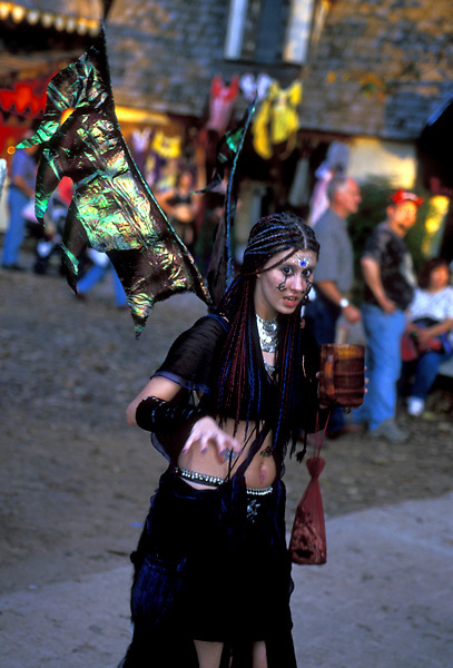 Stock photo of a girl dressed in a dark costume at the Texas Renaissance Festival in Plantersville Texas