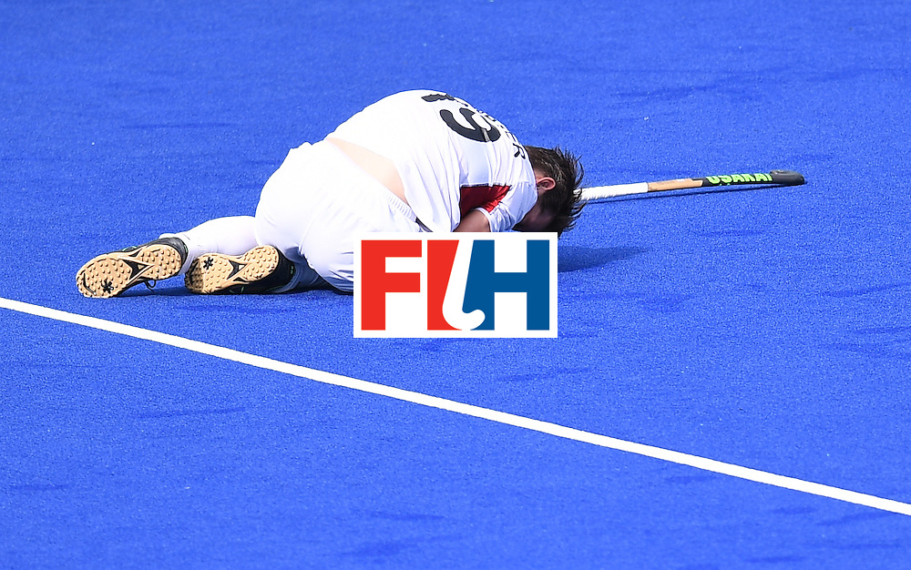 Belgium's Felix Denayer lies on the pitch during the men's field hockey Spain vs Belgium match of the Rio 2016 Olympics Games at the Olympic Hockey Centre in Rio de Janeiro on August, 11 2016. / AFP / MANAN VATSYAYANA        (Photo credit should read MANAN VATSYAYANA/AFP/Getty Images)