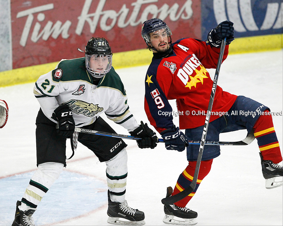 COBOURG, ON  - MAR 25,  2017: Ontario Junior Hockey League, playoff game between the Cobourg Cougars and the Wellington Dukes. Matthew Carroll #21 of the Cobourg Cougars protects the crease against Nic Mucci #9 of the Wellington Dukes during the third period.<br /> (Photo by Tim Bates / OJHL Images)