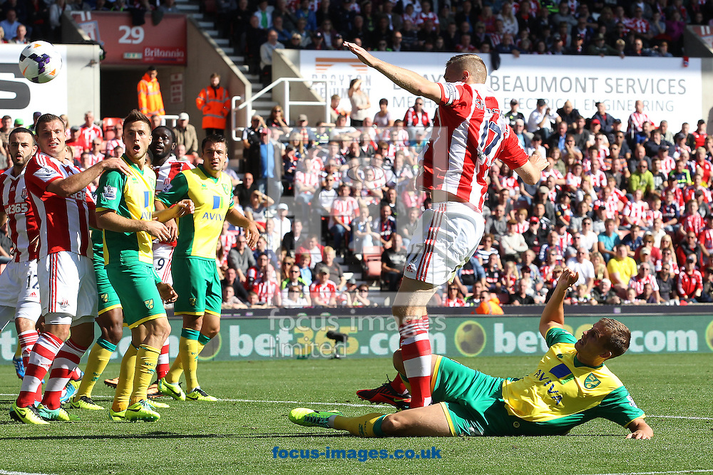 Picture by Paul Chesterton/Focus Images Ltd +44 7904 640267<br /> 29/09/2013<br /> Ryan Bennett of Norwich has a shot on goal during the Barclays Premier League match at the Britannia Stadium, Stoke-on-Trent.