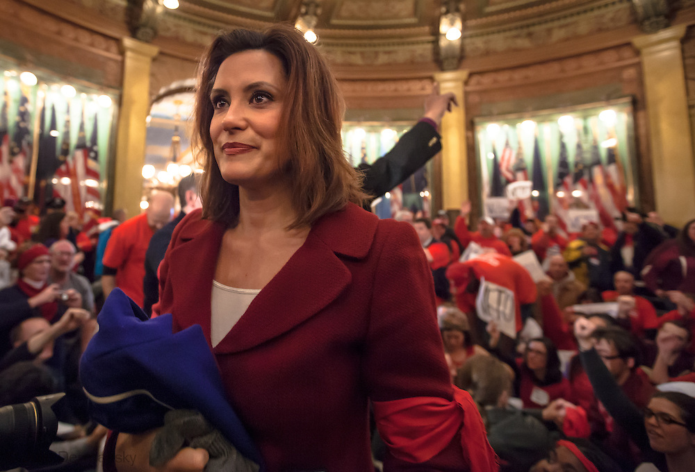 Michigan Senator the Democratic-minority leader Gretchen Whitmer in the MI State Capitol amung protesters taking part in a sit-in.
