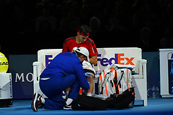 November 17, 2017 - London, England, United Kingdom - Dominic Thiem of Austria receives treatment in his Singles match against David Goffin of Belgium during day six of the Nitto ATP World Tour Finals at O2 Arena on November 17, 2017 in London, England. (Credit Image: © Alberto Pezzali/NurPhoto via ZUMA Press)