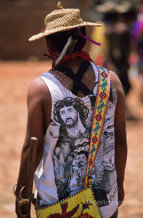 "The ""Judios"" paints their bodies simbolysing  the Evil forces and struggles in the streets looking for Jesus. Coras are a small indigenous people living scattered in the mountains of Sierra Madre Central in Mexican state of Nayarit. The Coras still follows their traditions, protecting in a very strong way their secret rites, that anthropologists believe the most interesting of Central America for their synchretism. The Holy Week, the most important religious event of the year, is characterized with impressive ceremonies. The catholic priest doesn't partecipate and the Black Centurion is the captain of Judea, the ?Jews?, the devil's militia looking for Jesus Christ to kill him. Violence is a essential part of the ceremonies and somebody can be killed in the struggles with wood swords."