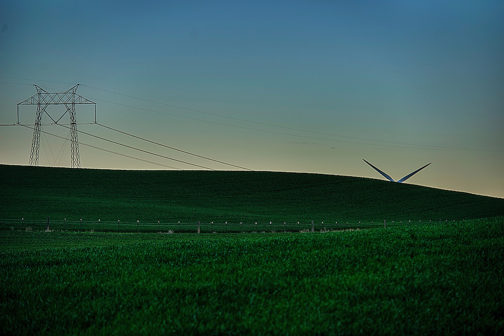 The Delta breezes of Solano County are producing electricity for thousands of SMUD customers. Located in the Montezuma Hills near Rio Vista, SMUD's wind farm was developed in 1994. As wind energy technology develops, the turbines have grown taller, more powerful and more reliable. The second phase turbines, at 415 feet tall, were the tallest in the U.S. at the time, and towered over the original models that stood only 241 feet high. Likewise, these models had a capacity of 3 MW each or enough to meet the annual electrical needs of a thousand SMUD households. Improvements in the technology allowed SMUD to replace the original turbines.