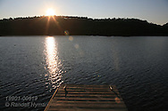 Sun rises over dock in Lake Superior's northernmost harbor at Nipigon, Ontario; Canada.