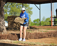 Volunteers place sod at Rivers Hill Park in Oxford, Miss. on Monday, April 22, 2013. Volunteers also installed playground mulch.