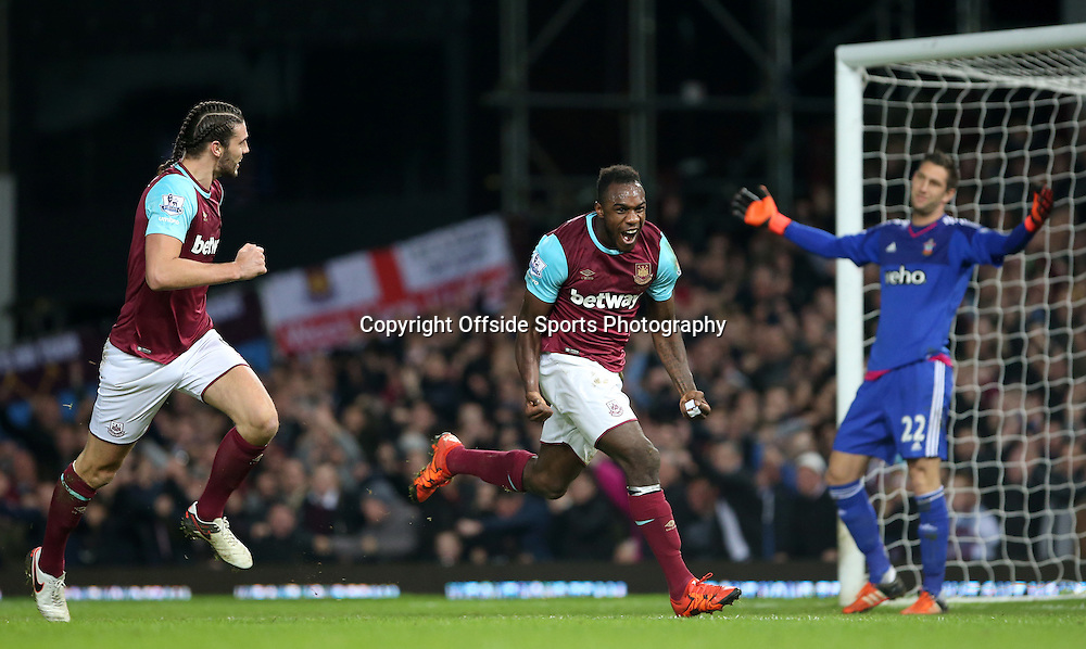 28 December 2015 - Premier League - West Ham United v Southampton<br /> Andy Carroll of West Ham runs to join Michail Antonio to celebrate his goal whilst Southampton goalkeeper Maarten Stekelenburg holds up his hands in disbelief behind<br /> Photo: Charlotte Wilson / Offside