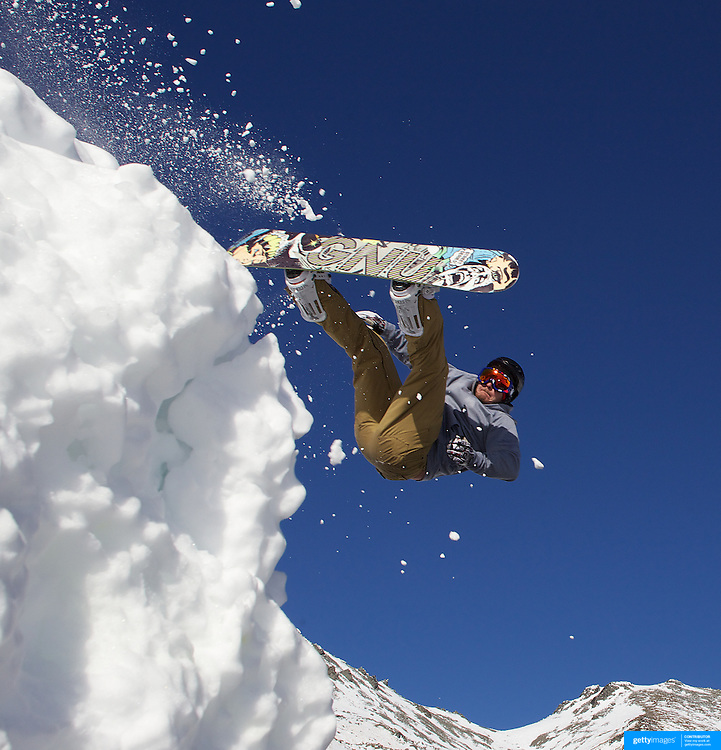 Snowboarder Matt Ayton, 22, from Sydney, Australia, takes to the air at The Remarkables Ski Fields, Queenstown, New Zealand during a session with 'The Air Bag'  a large inflatable airbag which breaks the fall of the participant on landing and allows valuable experience and a training aid for Aerial skiers and snowboarders. Queenstown, South Island, New Zealand, 18th July 2011
