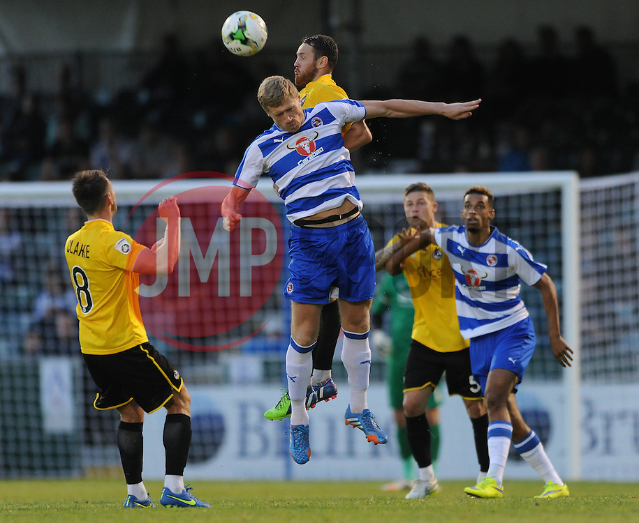 Tom Parkes of Bristol Rovers challenges for the header with Pavel Pogrebnyak of Reading - Mandatory by-line: Dougie Allward/JMP - 21/07/2015 - SPORT - FOOTBALL - Bristol,England - Memorial Stadium - Bristol Rovers v Reading - Pre-Season Friendly
