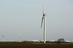 26 April 2008:   Hog buildings are surrounded by wind turbines that are a part of the Twin Grove wind farm east of Bloomington Illinois..
