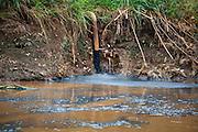 Toxic industrial wastes illegally dumped into the Citarum River by Gistex.  Jelegong village, Kabupaten Bandung...Credit: Andri Tambunan for Greenpeace