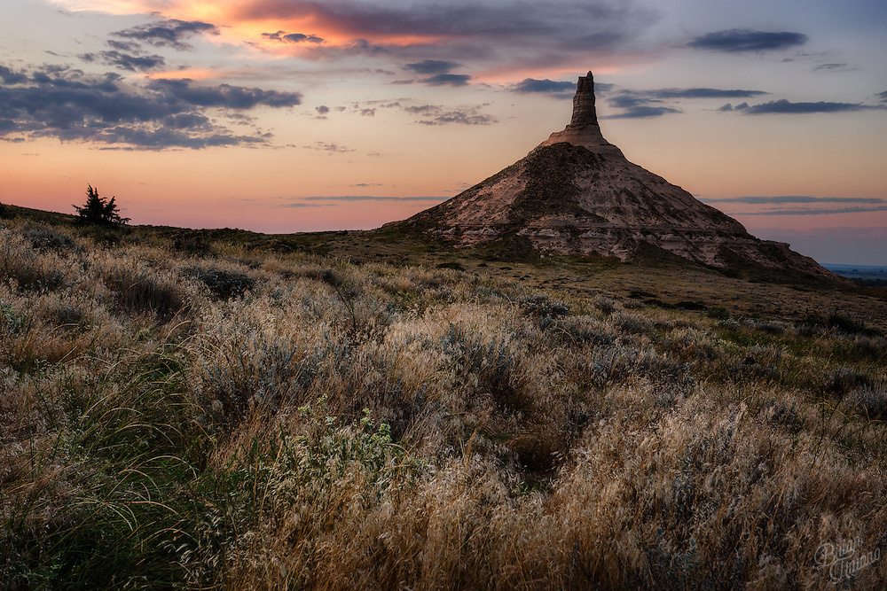 If you've every found yourself traveling across Nebraska, you may have an understanding of what the early settlers encountered during their westward journey (aside from Dysentery). It's a big place, with big skies, seemingly endless prairies and quite flat terrain. It must have been appreciable to see this 300 foot tall beacon of sandstone, now known as Chimney Rock, jutting out of the horizon. As a landmark, it indicated the travelers were heading in the right direction and would soon be entering the Rocky Mountain region.