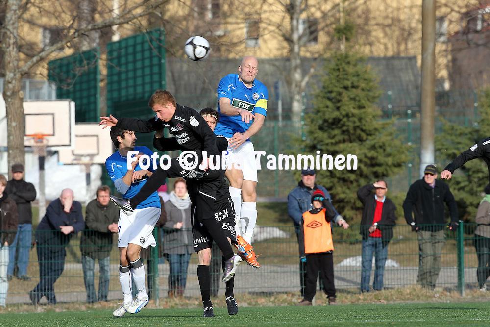 21.4.2011, Kisapuiston tekonurmi, Lahti..Suomen Cup 2011, 7.kierros, FC Lahti - FC TPS Turku..Jarno Heinikangas (TPS) v Sami Tiittanen (FC LAhti)..©Juha Tamminen.