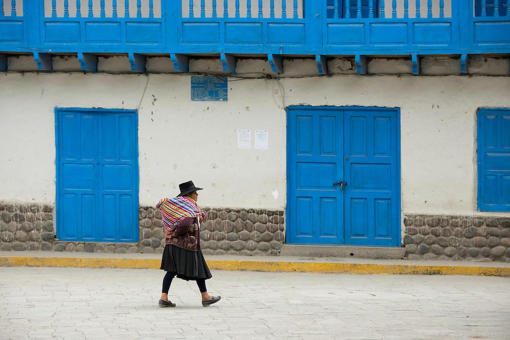 South America,PeruSouth America,Peru, Ajanaco, woman walking in town square