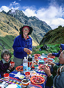 Trekkers eat a lunch of healthy food on Dead Woman's Pass, Inca Trail, Cordillera Vilcabamba, Andes mountains, Peru, South America. Published in Wilderness Travel 2016 Catalog of Adventures. For licensing options, please inquire.