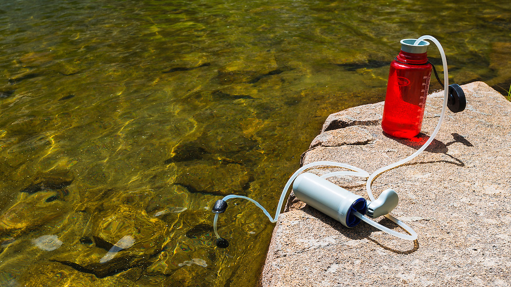 Water purifier on the shore of Fern Lake, Ansel Adams Wilderness, June Lake, California USA
