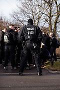 Magdeburg | 18 Jan 2014<br /> <br /> ACHTUNG BESONDERE HONORARKONDITIONEN!<br /> <br /> Am Samstag (19.01.2014) marschierten etwa 1000 Neonazis bei einem &quot;Gedenkmarsch&quot; durch Magdeburg, um der Bombardierungen der Stadt im 2. Weltkrieg zu &quot;gedenken&quot;.<br /> Hier: Ein Beamter der Bundespolizei an der Haltestelle Magdeburg-Herrenkrug vor dort wartenden Neonazis.<br /> <br /> &copy;peter-juelich.com<br /> <br /> [No Model Release | No Property Release]