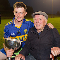 Eoin FItzgerald with his grandfather Pa Crowe after Newmarket-on-Fergus's Minor B Hurling final win