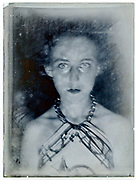 vintage spooky lighted portrait of a young adult woman