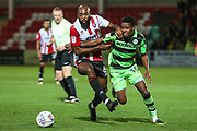 Forest Green Rovers Reece Brown(10) tangles with Cheltenham Town's Nigel Atangana(6) during the EFL Trophy match between Cheltenham Town and Forest Green Rovers at Whaddon Road, Cheltenham, England on 3 October 2017. Photo by Shane Healey.
