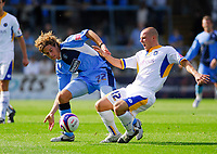 Photo: Leigh Quinnell.<br /> Wycombe Wanderers v Shrewsbury. Coca Cola League 2. 22/09/2007. Wycombes Sergio Torres tangles with Shrewsburys Ben Hurd.
