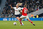Chloe Peplow takes on Kim Little during the FA Women's Super League match between Tottenham Hotspur Women and Arsenal Women FC at Tottenham Hotspur Stadium, London, United Kingdom on 17 November 2019.