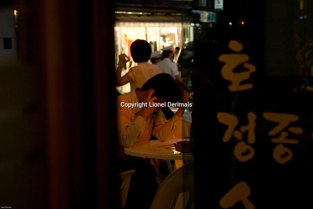 Businessman in a restaurant, Seolleung, Seoul, South Korea. 2009