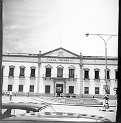The Leal Senado Building (Portuguese for Loyal Senate) was the seat of Portuguese Macau's government (Legislative Assembly of Macau and Municipal Council of Macau). It is located at one end of the Senado Square. The title was bestowed on Macau's government in 1810 by Portugal's Prince Regent João, who later became King John VI of Portugal. This was a reward for Macau's loyalty to Portugal, which refused to recognise Spain's sovereignty during the Philippine Dynasty that it occupied Portugal, between 1580 and 1640. A plaque ordered by the king commemorating this can still be seen inside the entrance hall.