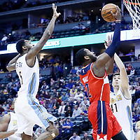 08 March 2017: Washington Wizards guard John Wall (2) goes for the layup past Denver Nuggets guard Will Barton (5) during the Washington Wizards 123-113 victory over the Denver Nuggets, at the Pepsi Center, Denver, Colorado, USA.