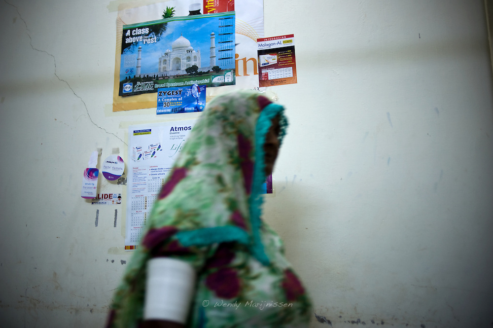 A woman with traditional bangles around her arms leaves the local doctors' office. Traditional customs like these bangles often create problems in emergency situations, making it hard to take the blood pressure or give injections. Mithi, Tharparker, Pakistan, 2010