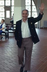 man waving hello to someone