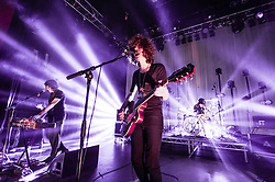 © Licensed to London News Pictures. 08/03/2014. London, UK.   Temples performing live at Shepherds Bush Empire. In this pictures - James Edward Bagshaw (centre), Adam Smith (left), Sam Toms (right).  Temples are an English psychedelic rock band consisting of members James Edward Bagshaw (singer/guitarist), bassist Thomas Edison Warmsley (bass), Sam Toms (drums) and Adam Smith (keyboards/guitar/vocals).   Photo credit : Richard Isaac/LNP