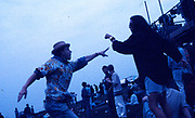 Raver pointing to the stage at the first outdoor rave up North, The Gio Goi Joy Rave run by Anthony and Chris Donnelly, Ashworth Valley, Rochdale, 5th August 1989.