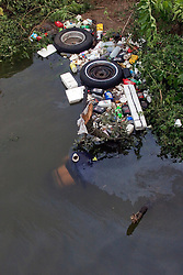 29 August, 2005. New Orleans, Louisiana.<br /> Hurricane Katrina hits New Orleans. A victim of the catastrophic flooding bobs amidst the debris in the murky waters of the 9th ward. <br /> Photo; Charlie Varley.
