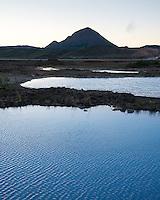 Blue geothermal water at lake Mývatn, Mount Hlíðarfjall in background. North Iceland.