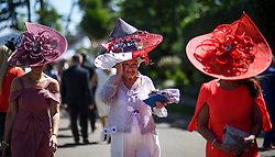 © Licensed to London News Pictures. 21/06/2018. London, UK. Racegoers in elaborate hats enjoy Ladies Day at Royal Ascot at Ascot racecourse in Berkshire, on June 21, 2018. The 5 day showcase event, which is one of the highlights of the racing calendar, has been held at the famous Berkshire course since 1711 and tradition is a hallmark of the meeting. Top hats and tails remain compulsory in parts of the course. Photo credit: Ben Cawthra/LNP