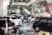 JAKARTA, INDONESIA, MAY 2013: Middle calss family looks for a new car in the<br /> Astra International Showroom in Sunter area, North of Jakarta, May 2013.<br /> <br /> &copy; Giulio Di Sturco for Bloomberg Markets