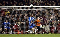 Photo: Chris Ratcliffe.<br /> Arsenal v Wigan Athletic. Carling Cup. 24/01/2006.<br /> Sol Campbell blasts an easy chance over in full time