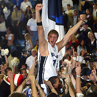(SPORTS) West Long brnach 3/10/2004  Monmouth's #15 BRIAN BOXLER is hoisted on the shoulders of fans as he reacts to winning the NEC Championship  Michael J. Treola Staff Photographer..M JT