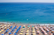 An aerial view of umbrellas and sea on Elli Beach, Rhodes Town, Rhodes, Dodecanese Islands, Greece