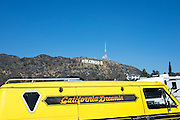 "© Licensed to London News Pictures. 15/02/2015. Los Angeles, USA A van with the words ""California Dreaming"" parked near to the sign. Tourists photograph the Hollywood sign in Los Angeles, California. Photo credit : Stephen Simpson/LNP"